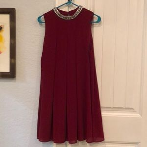 Red dress with blingy neck detail
